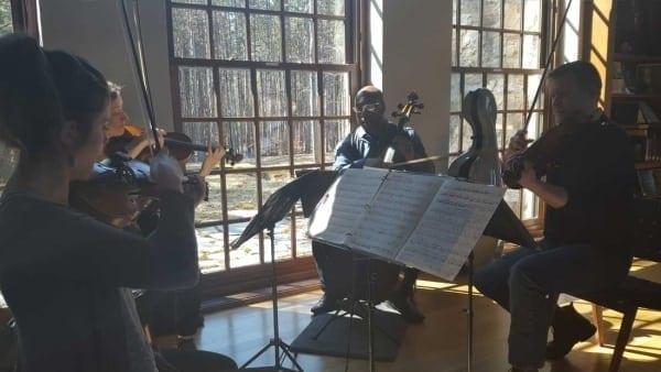 How is a chamber music ensemble like the Savoir Faire team?